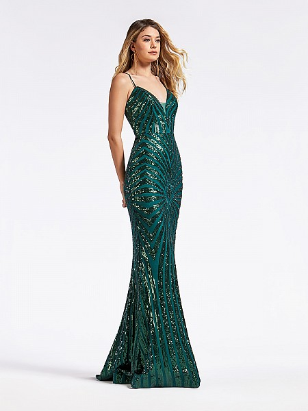 Long green formal gown with illusion inset on deep sweetheart neckline and sparkly sequins