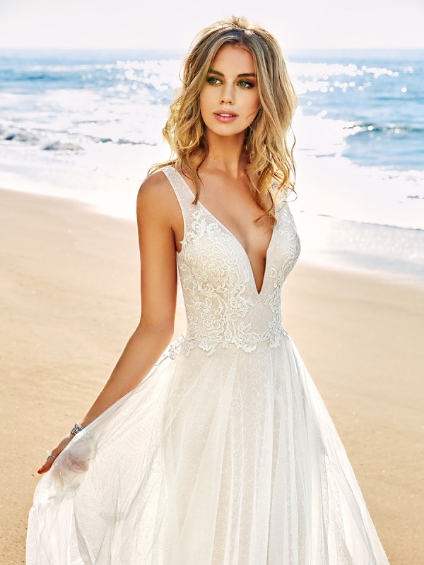 Simply Val Stefani S2081 ethereal bohemian lace A-line wedding dress with sexy low neckline and flowing skirt