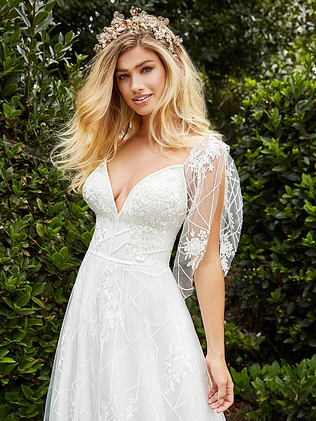 Style EVEREST unique A-line bridal gown with deep v-neck and beautiful tulle bow at shoulder